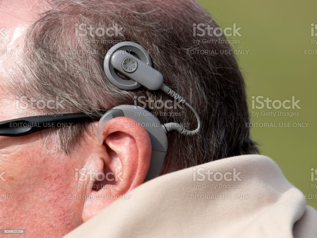 Man with Cochlear Implant stock photo