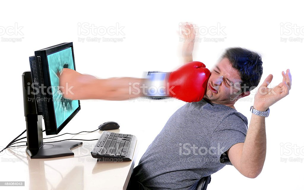 man with computer hit by boxing glove social media cybermobbing stock photo