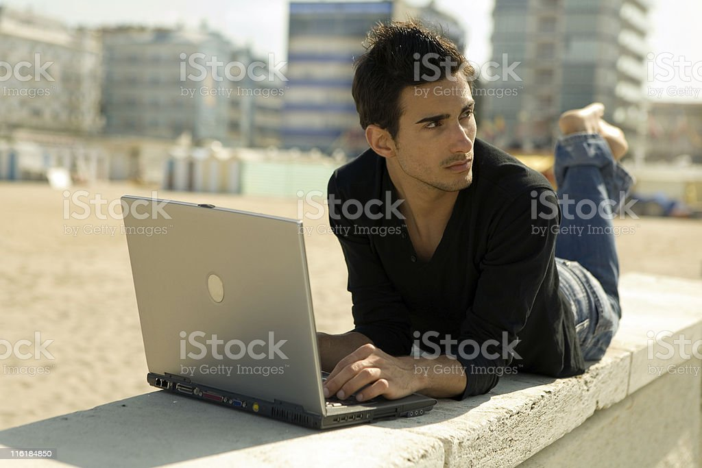 man with computer working outdoor royalty-free stock photo