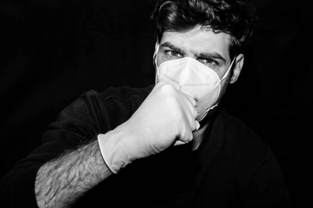 Man with cough, gloves and mask
