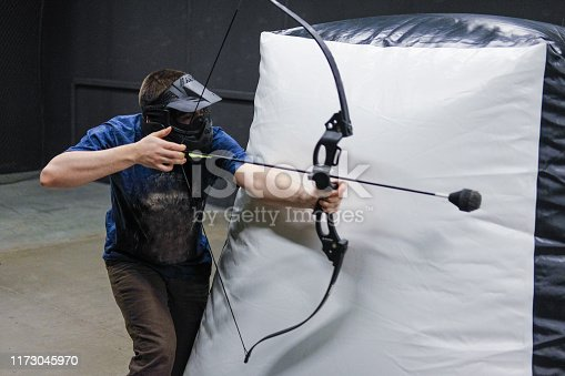 902406974 istock photo Man with crossbow arrows bow. The Archer takes aim, sharpshooter. Crossbow club. 1173045970