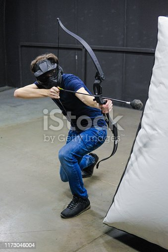 902406974 istock photo Man with crossbow arrows bow. The Archer takes aim, sharpshooter. Crossbow club. 1173046004