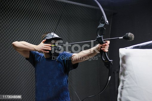 902406974 istock photo Man with crossbow arrows bow. The Archer takes aim, sharpshooter. Crossbow club. 1173046586
