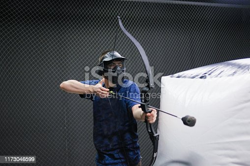 902406974 istock photo Man with crossbow arrows bow. The Archer takes aim, sharpshooter. Crossbow club. 1173046599