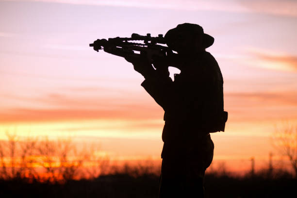 man with cross-bow silhouette - crossbow stock pictures, royalty-free photos & images
