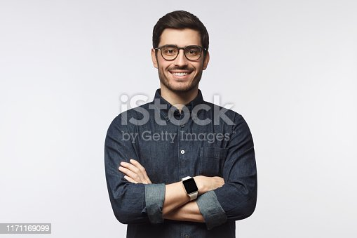 Man with crossed arms isolated on gray background
