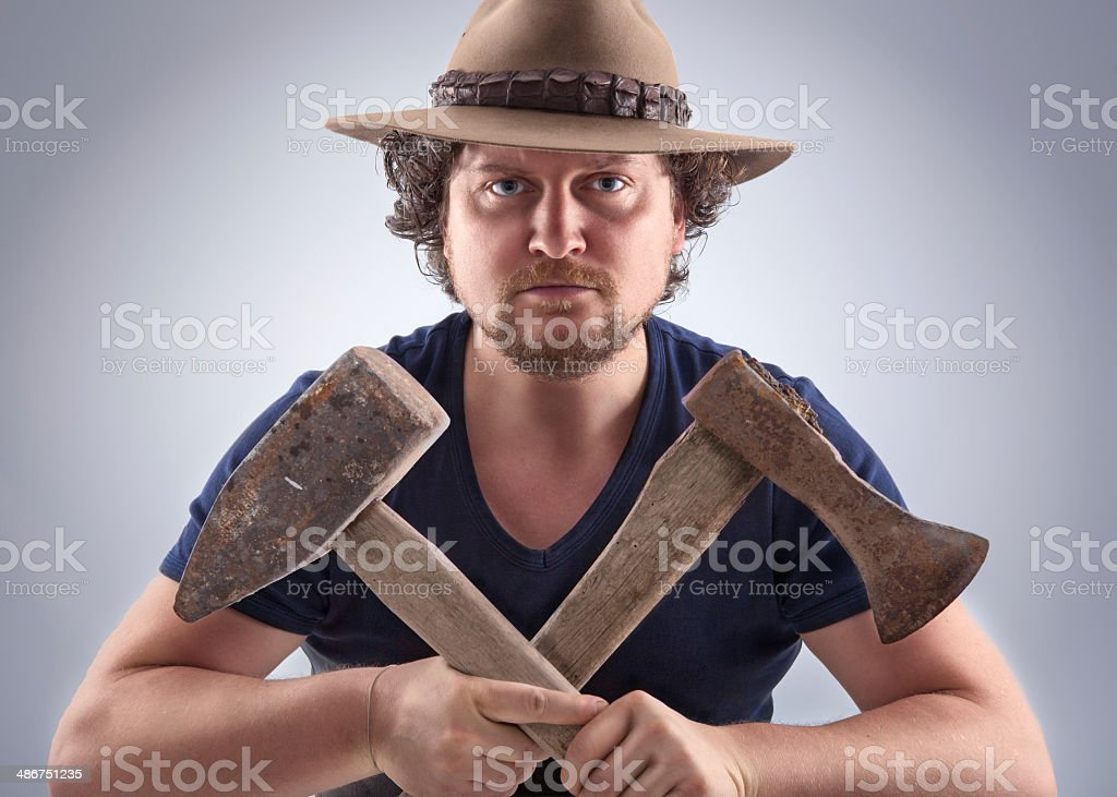 Man with crossed tools royalty-free stock photo