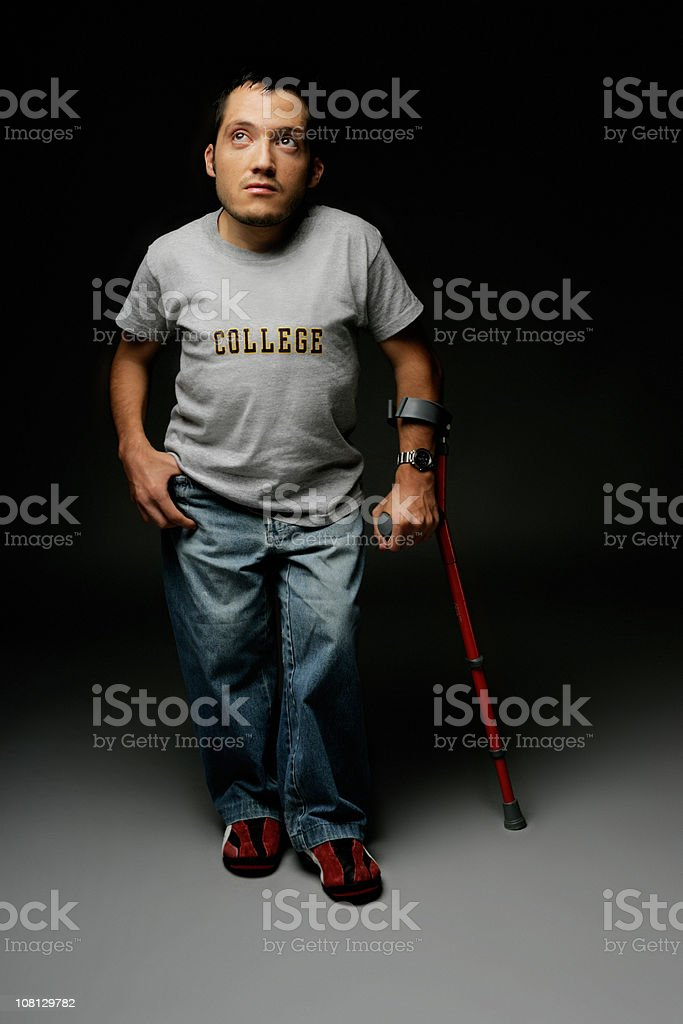 Man with crutch royalty-free stock photo