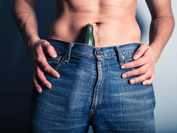 mann seine hose mit gurke - essen tattoos stock-fotos und bilder