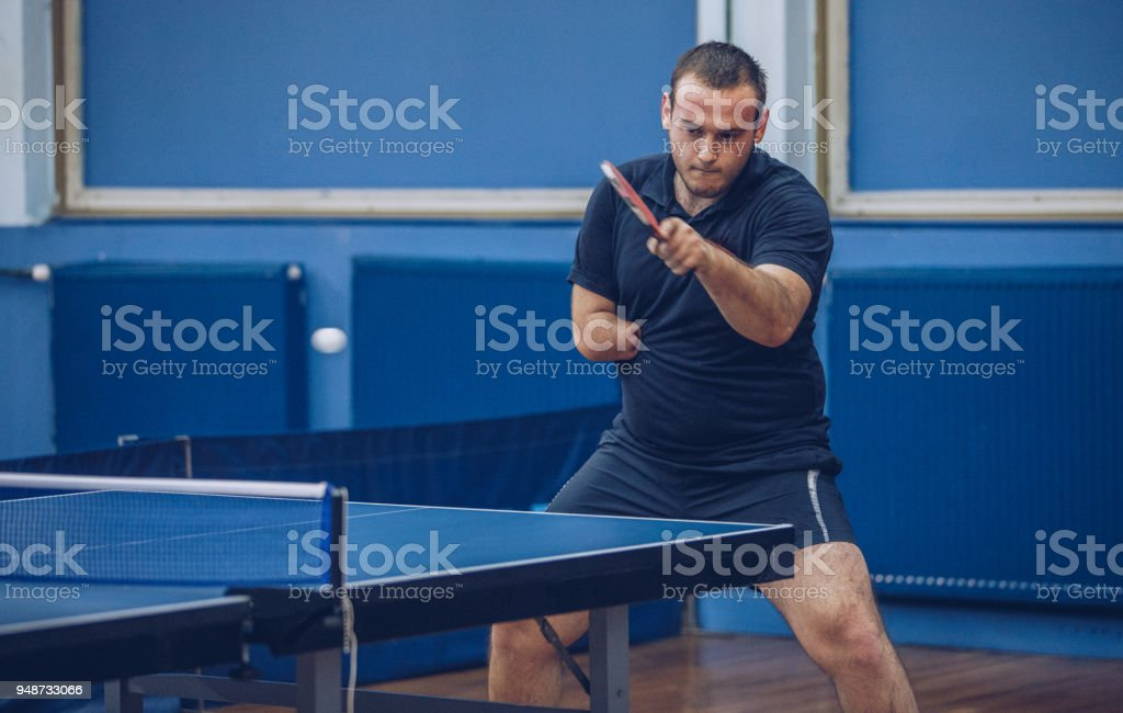 Man playing table tennis stock photo