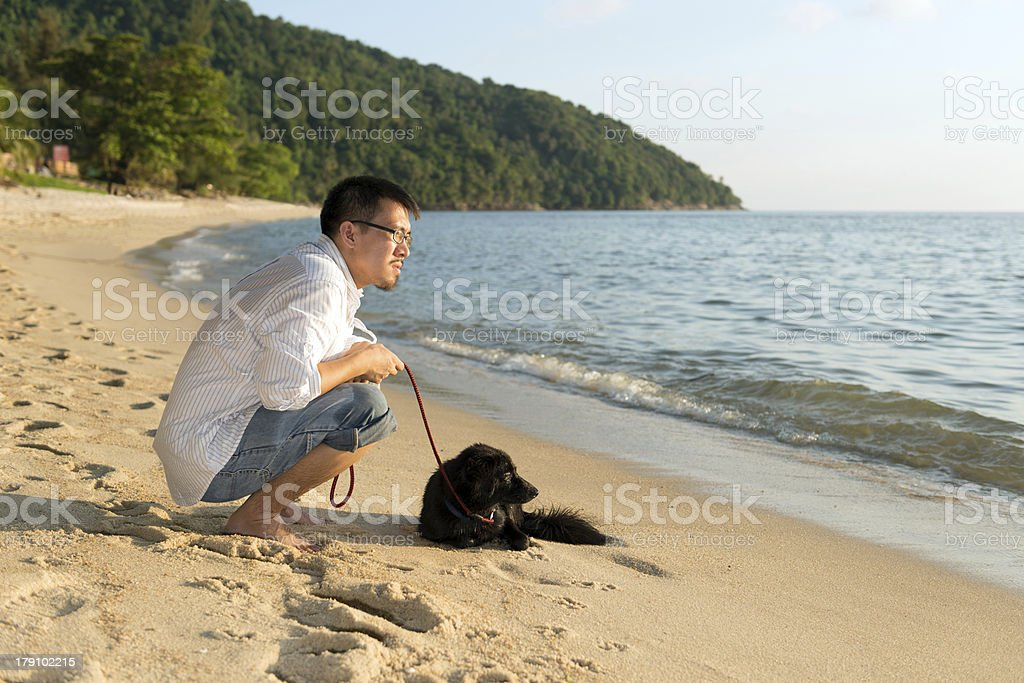 Man with dog at beach royalty-free stock photo