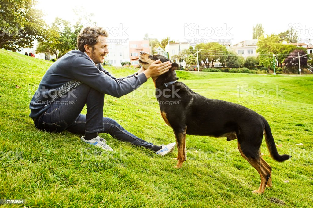 Man with dog at the Dolores Park stock photo