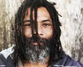 Homeless man with Rastafarian dreadlocks.