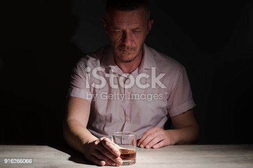istock Man with drinking problem 916266066
