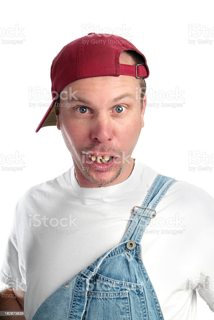Man with Dumb Expression and Bad Teeth Wearing Overalls stock photo