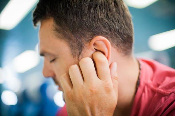 Man With Ear Ache stock photo