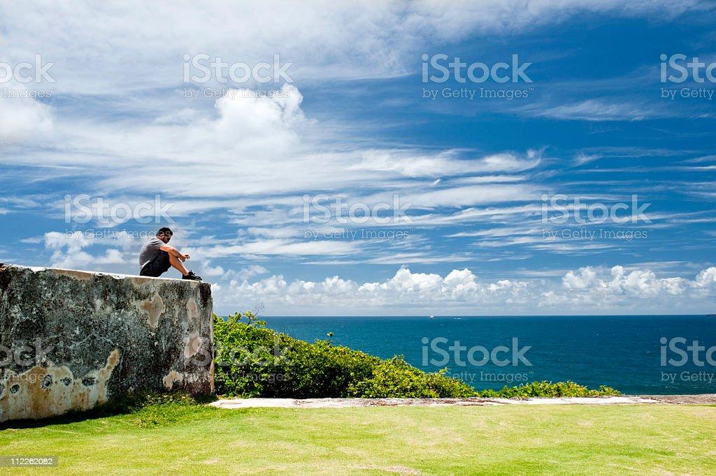 man with earphones watching ocean royalty-free stock photo