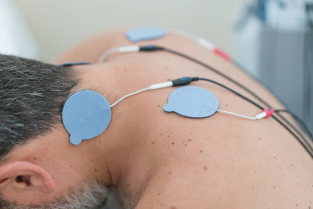Man With Electrodes On Neck stock photo