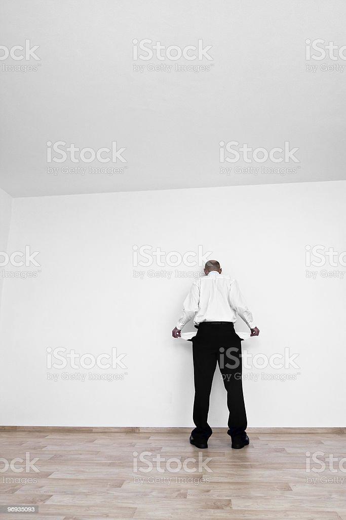 Man with empty pockets royalty-free stock photo