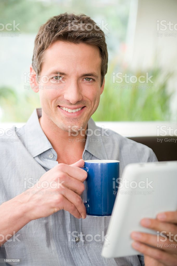Man with e-reader royalty-free stock photo