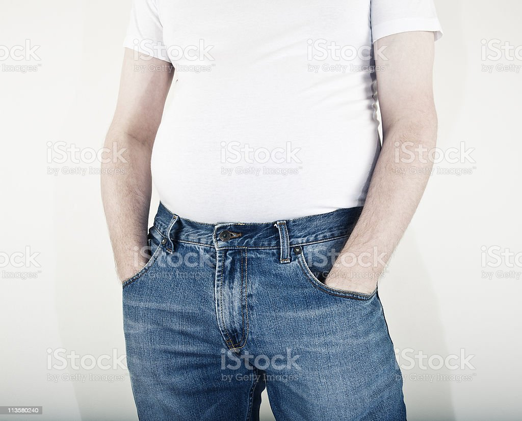 Man with excess weight around middle stock photo