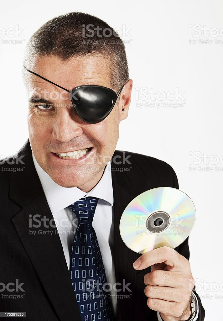 Man with eye patch and CD: music or software pirate stock photo