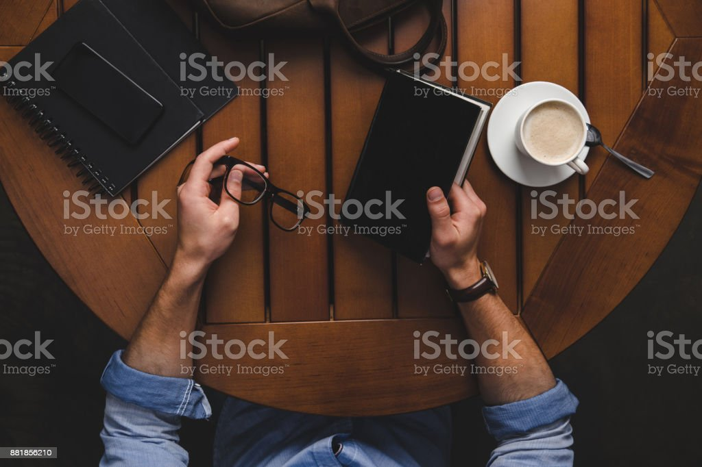 man with eyeglasses and notepad stock photo