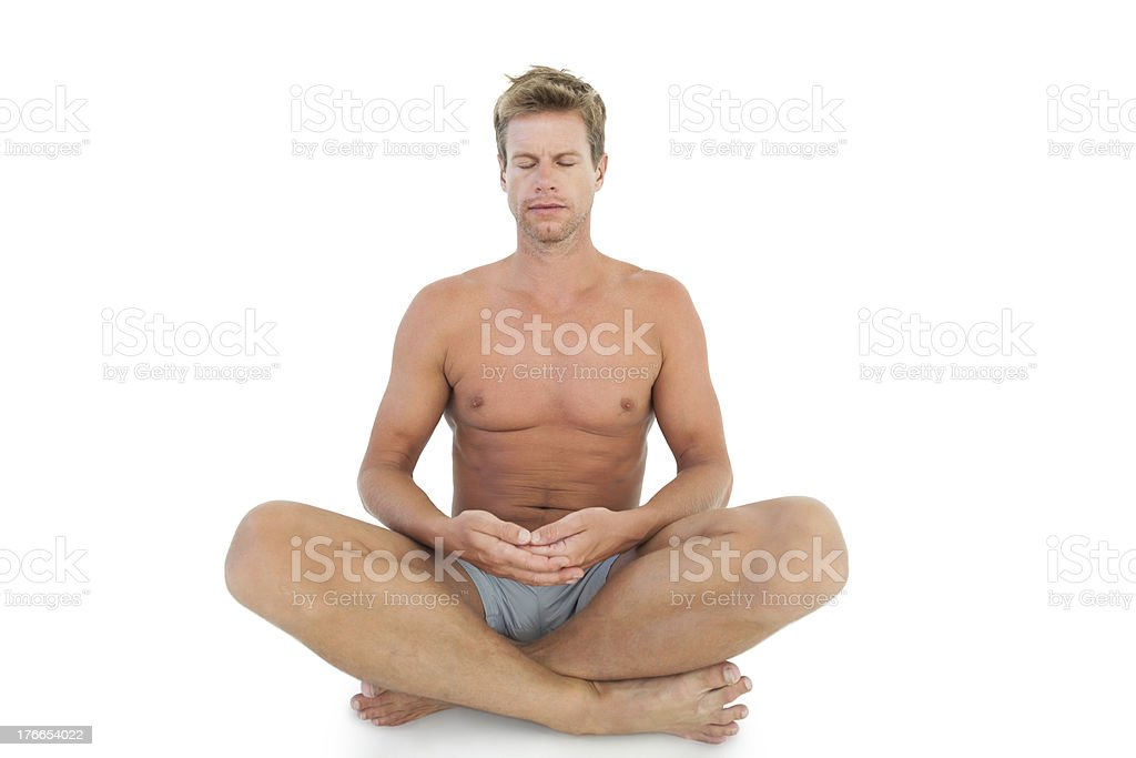 Man with eyes closed meditating on the floor royalty-free stock photo