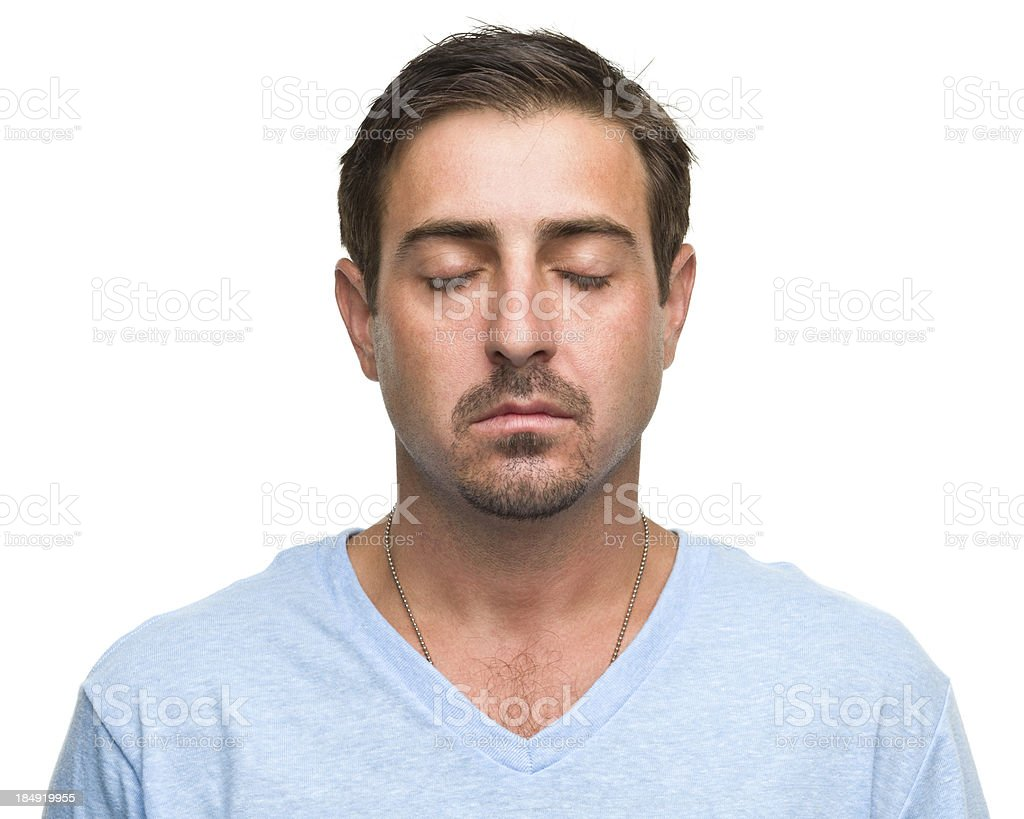 Man With Eyes Closed Meditating stock photo