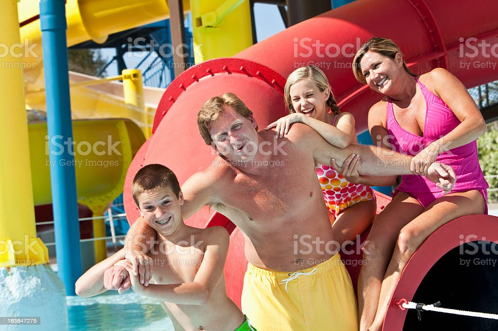 Man with family at water park royalty-free stock photo