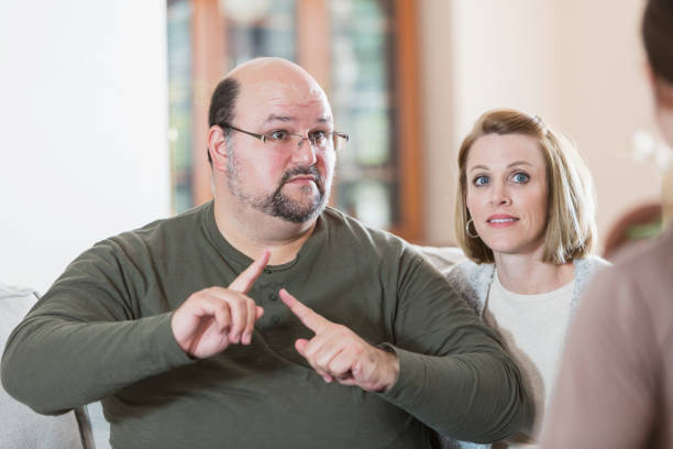 man with family, using sign language - sign language stock photos and pictures