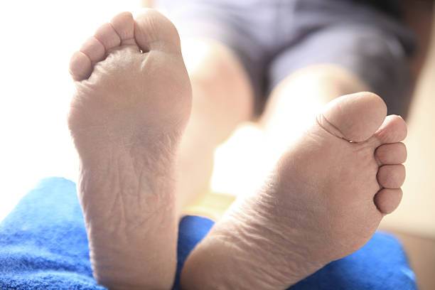 man with feet raised - old man feet stock photos and pictures
