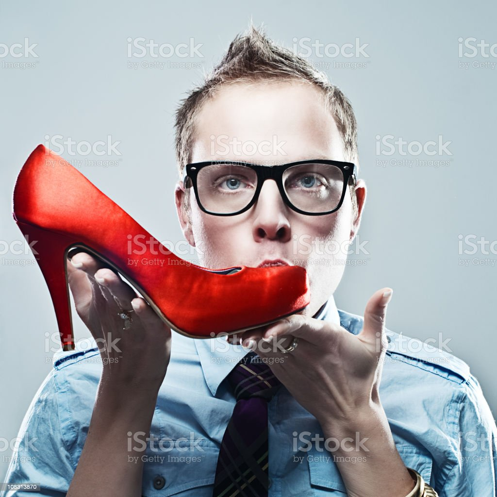 man with female hands holding a shoe royalty-free stock photo