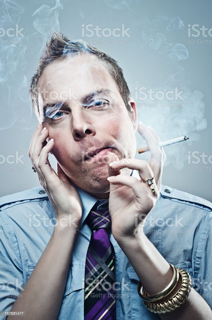 man with female hands smoking royalty-free stock photo