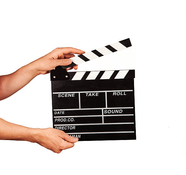 Man with film clapper on white background stock photo