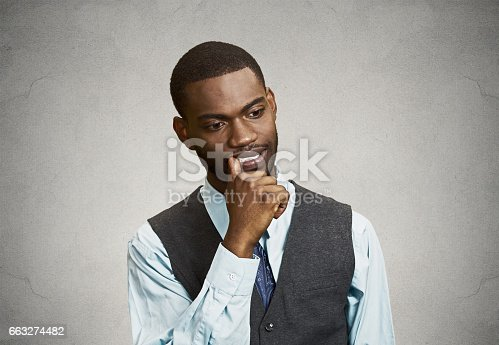 istock man with finger in mouth, sucking thumb, biting fingernail in stress, deep thought 663274482