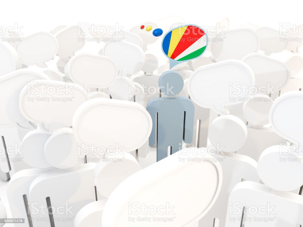 Man with flag of seychelles in a crowd stock photo
