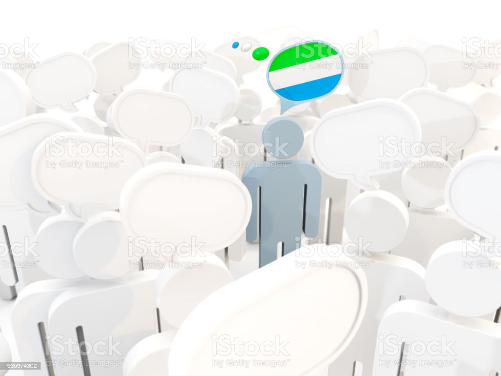 Man with flag of sierra leone in a crowd stock photo