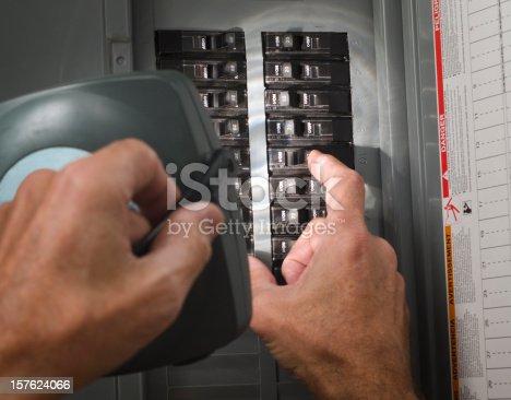 man throwing circuit breaker at residential service panel