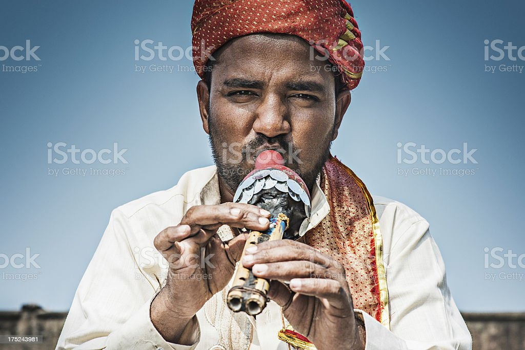 Man with flute stock photo
