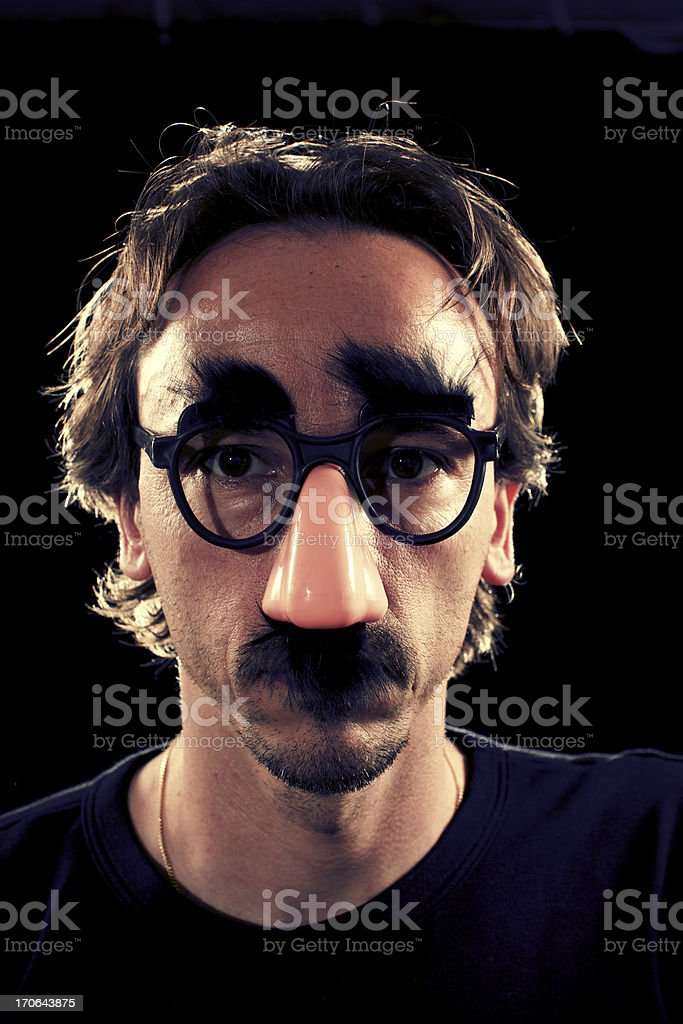 Man with funny glasses stock photo