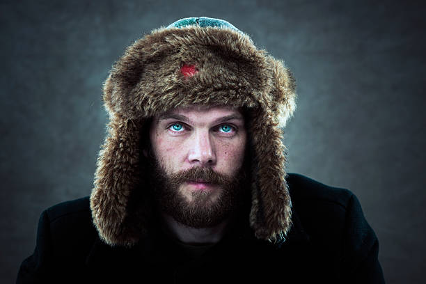 Man with fur hat stock photo
