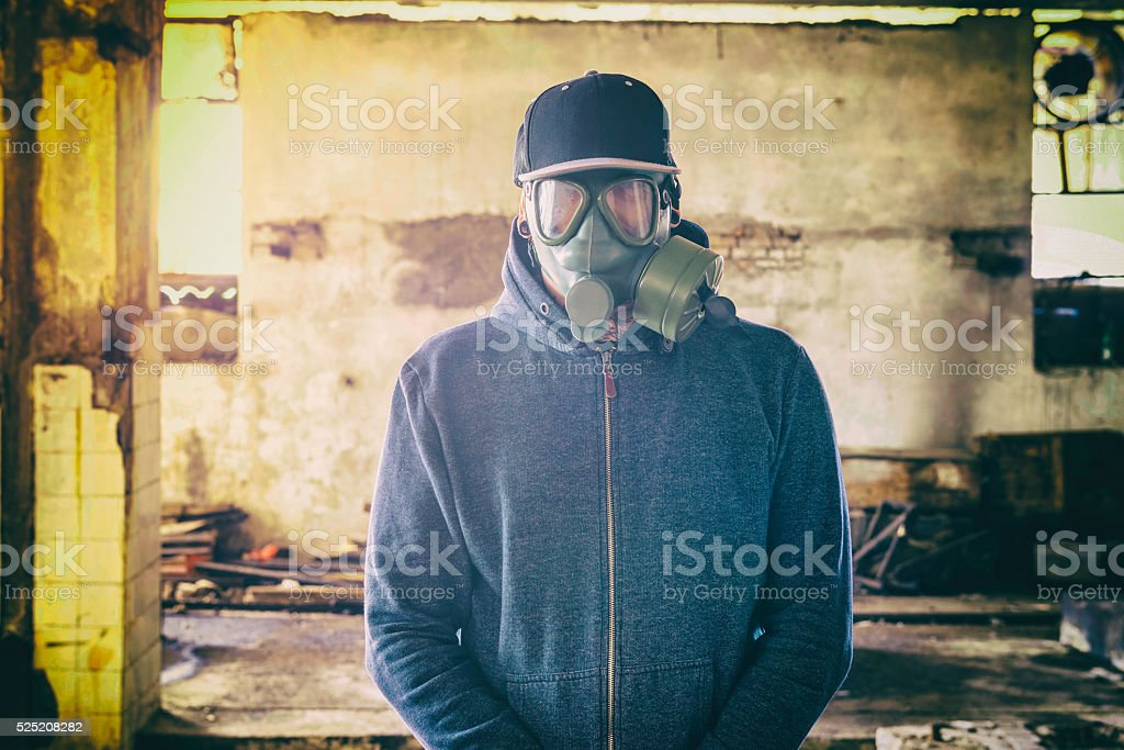 Man with gas mask stock photo