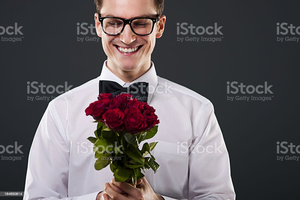 Man with glasses holding red roses royalty-free stock photo