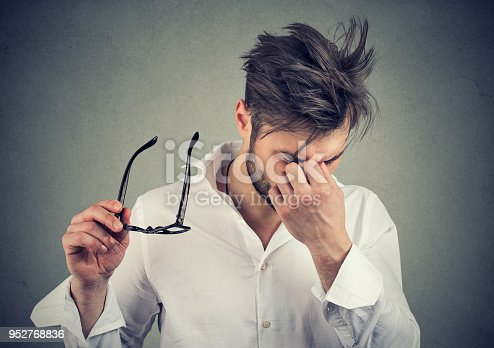 626964348istockphoto man with glasses suffering from eyestrain 952768836