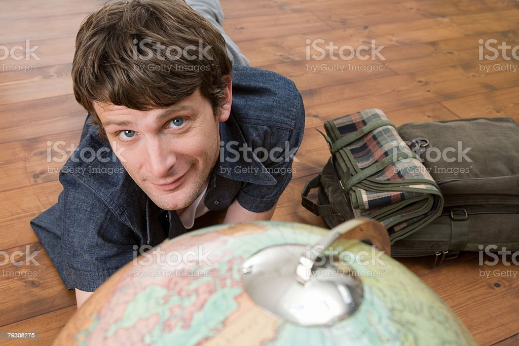 Man with globe and backpack royalty-free stock photo