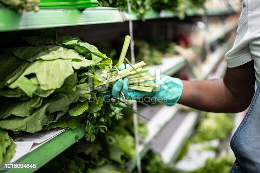 927641110 istock photo Man with gloves shopping in supermarket 1218094648