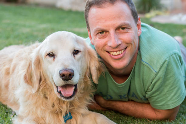 Man with Golden Retriever dog. stock photo