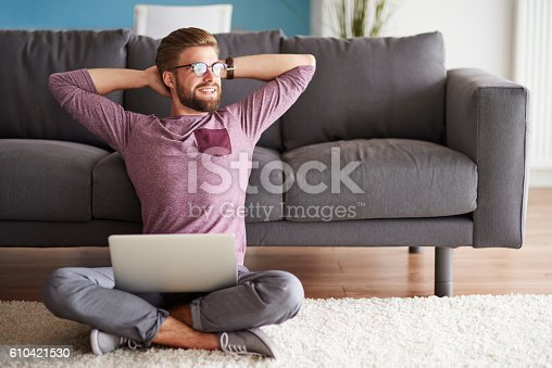Man with good vibes sitting on the floor