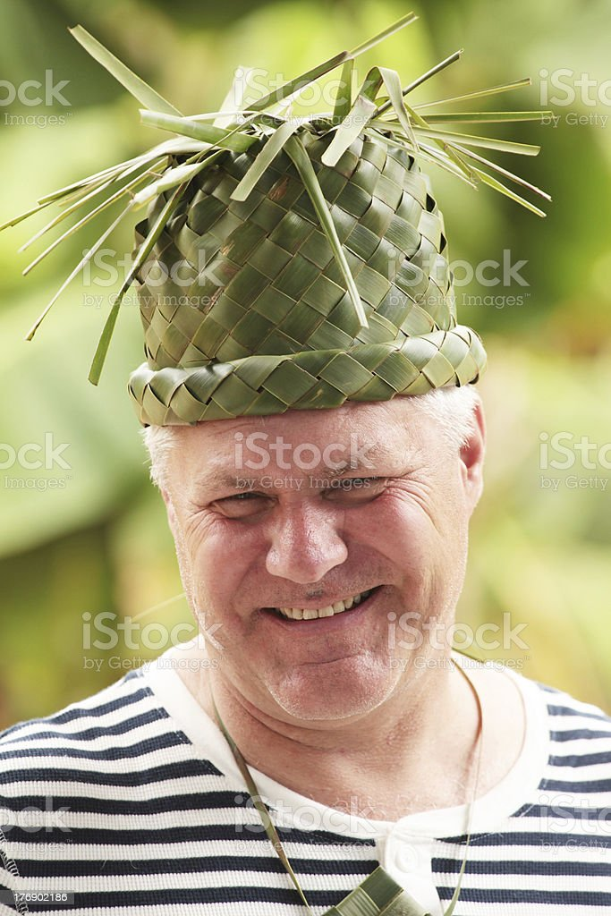 Man with green hat stock photo